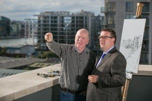 Gibson Hotel manager Adrian McLaughlin, surveys the view from the hotel with newly appointed Artist in Residence, John Morris