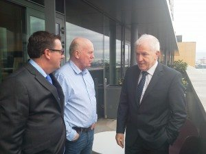 Minister for Arts, Heritage and the Gaeltacht, Jimmy Deenihan TD, with Gibson Hotel general manager, Adrian McLaughlin, and artist in residence John Morris at the artist in residence launch.