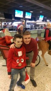 TV personality Brian Ormond with Charlie Maguire about to depart on the Cityjet/Temple Street Hospital Christmas flight